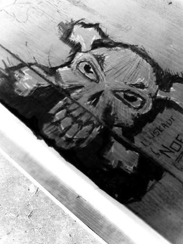 skull carving inverted bw