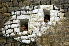 Boys at windows on a painted wall - Yemen (Eric Lafforgue) Tags: voyage travel republic felix middleeast arabic arab arabia yemen arabian sanaa ramadan yemeni yaman middleast arabie moyenorient jemen lafforgue arabiafelix  arabieheureuse  arabianpeninsula    ericlafforgue iemen lafforguemaccom mytripsmypics imen imen yemni    jemenas    wwwericlafforguecom  alyaman ericlafforguecomericlafforgue contactlafforguemaccom yemenpicture yemenpictures