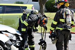 INSPECTING THE DAMAGE (MIKECNY) Tags: car fire crash accident damage firefighter inspect boght
