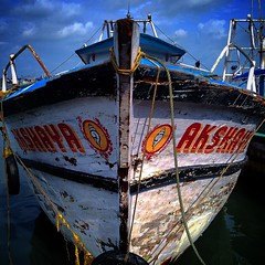 Escape to water! (melvin mathew) Tags: india fish boat fishing harbour kerala boating kozhikode