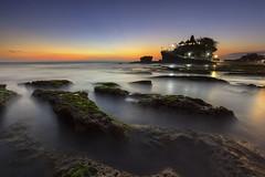 Last Light at Tanah Lot (Gede Suyoga) Tags: morning sunset sea sky bali cloud reflection beach nature water beautiful sunrise canon indonesia landscape temple eos boat asia reef pura tanahlot pemandangan waterscape 5dmarkii