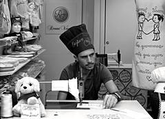 andalucia: superchef (gregjack!) Tags: spain andalucia seville man hat chef sewing tapestry superchef street streetphotography bw sony sonyrx10m3 black white