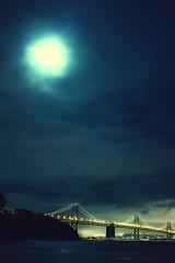 One Day One Night (Thomas Hawk) Tags: baybridge california sanfrancisco treasureisland usa unitedstates unitedstatesofamerica yerbabuenaisland bridge moon fav10 fav25 fav50 fav100