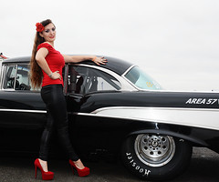 Holly FT   144 (Fast an' Bulbous) Tags: 57 chevy chevrolet american car vehicle automobile drag race fast speed power people outdoor girl woman chick babe long brunette hair red shoes high heels stilettos tight leather jeans pvc leggings model pinup beauty nikon santa pod england