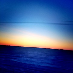 Sunset 🌅 (jaedyn willett) Tags: sunset beautiful tache manitoba blue snow cold chilly wires trees backround orange yellow black