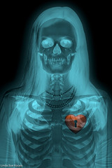 Under Lock & Key (Linda Sue Kocsis) Tags: red woman color girl dark skeleton skull photo scary key colorful noir sitting glow heart bright chest ghost surreal radiation haunted photograph sit radioactive glowing bone radioactivity keyhole