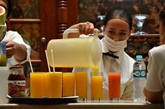 Juice Counter (Pedestrian Photographer) Tags: city orange woman water girl de mexico restaurant glasses bottle cafe mask juice guard july mexican grapefruit surgical jugos pour thursday sneeze pouring tacuba ribbet 2015