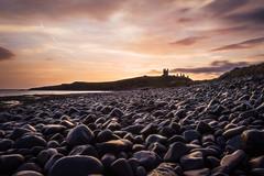 Sunrise at Dunstanburgh Castle, Northumberland (Photography Revamp) Tags: yellow sunriseatdunstanburghcastle northumberland england landscape seascape seacoast sea rocks sunrise beach castle gb uk