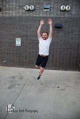 Doug (Levi Smith Photography) Tags: wall shorts shirt tshirt white jump fly shoes action pose fashion male model men mans man mens clothes happy smile summer flying jumping joy parking lot portrait