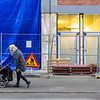 IMG_58705 (David Falck) Tags: construction fence sign baby stroller person hunched over göteborg blue sheet tarp square