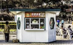 Refreshment Drink Stand (Baron Reznik) Tags: urban horizontal korea structure amusementpark puto everydaylife themepark northkorea sodo flatland pyongyang chosun changan dprk colorimage ryugyong  democraticpeoplesrepublicofkorea      chosnminjujuiinminkonghwaguk builtstructure  canon28300mmf3556lisusm  kaesonyouthpark  kisong   ryugyng pyeongyangjikhalsi hwangsong rakrang sgyong hogyong capitolofwillows pyngyangchikhalsi