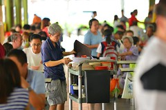 Elderly Cleaner Clearing Table Top at a Hawker Centre (CleaningAsia.com) Tags:
