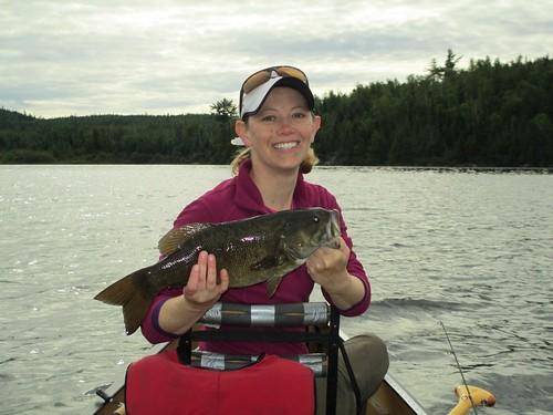 pose holding fisherwoman canoeing canoe lake happy smile woman fish fishing smallie smallmouth bass caught catch bwca bwcaw boundarywaters