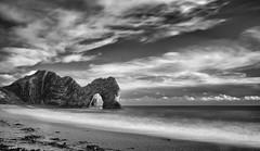 Durdle Door (Rob Clowes) Tags: fujifilm fujixpro1 f28 18 durdledoor dorset durassic niksoft silverefexpro2 bw blackwhite monochrome coast rocks water waves littlestopper sea coastline clouds longexposure sky