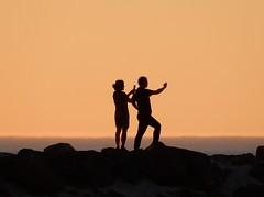 Sunset Selfies (mikecogh) Tags: glenelg sunset silhouette narcissism selfies rocks breakwater bodylanguage