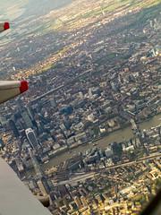 looking down [explored] (carol_malky) Tags: sky sun london thames skyscraper towerbridge plane river flight wing fromabove landing lookingdown toweroflondon thegherkin walkietalkie explored theshard