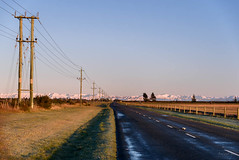 Slight Purple Haze (Jocey K) Tags: road trees light newzealand sky snow mountains sunrise landscape farmland southisland midcanterbury blackice canterburyhighcountry
