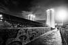 Heading Home, Cardonald (john&mairi) Tags: footbridge railway line graffiti bw blackwhite mono monochrome figure silhouette highrise queensland gardens cardonald glasgow scotland