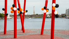 Balloons beside #Dublin's Grand Canal Dock (Joe Dunckley) Tags: dublin dublindocklands dublinport grandcanaldock ireland pigeonhouse poolbeggeneratingstation poolbegpowerstation republicofireland balloon chimney dock harbour industrial industry powerstation sculpture water