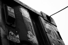 Corner (6079 Jones, P) Tags: jimmycauty aftermath dislocation principle shipping container bedfordshire bedford panacea museum gardenofeden adp art models dystopia riot canon eos 1200d canonefs1855mmiii yongnuo50mmf18 nifty fifty graffiti img5669 blackandwhite monochrome stickers