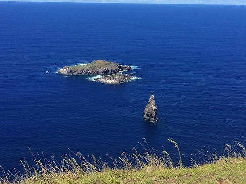 Birdman Island in deep blue Pacific Ocean off of Easter Island