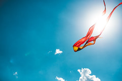 Fireball (charlie rocket photography) Tags: blue light red summer sky sun white kite color clouds contrast colorful wind flight summertime