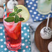 strawberry and other lemonade with straw and mind and ice and cake pops on polka dot napkin