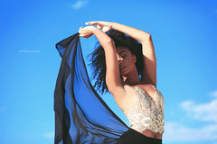 Skybound (Kelly McCarthy Photography) Tags: woman model beautiful beauty fashion style blue bluesky catchycolorsblue sky clouds skirt gold golden movement emotion wind windy outdoors lightandshadow shadows naturallight sunlight light croptop pose