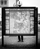 You are here. (Mister G.C.) Tags: blackandwhite bw ricoh ricohgr streetphotography urbanphotography candid street shot image photograph people monochrome town city map legs feet hidden behind zonefocus zonefocusing snapfocus pointshoot mistergc schwarzweiss strassenfotografie niedersachsen lowersaxony deutschland europe