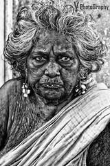 A Strange Portrait (Vigneshwaran photojournalist) Tags: granny madurai tamilnadu india indian lady female earing face wrinkles eyes stare village