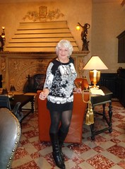 Too Risque For A Classy Hotel Lobby? (Laurette Victoria) Tags: hotel lobby pfisterhotel milwaukee wisconsin woman dress tights boots silver laurette