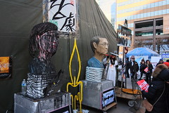 "Seoul Korea Kwanghwamun candle rally February 11 2017 'peanut gallery' of effigies attracting scorn and vuvuzela-ing - ""Paint It Black"" (moreska) Tags: seoul korea kwanghwamun candle rally february 11 2017 demonstration freespeech socialchange artists blacklist currentevents effigies dummies caricature crowd unstaged street candid vuvuzela costume slogan impeachment hangul freeexpression razor reflection mirror tents publicsquare 광화문 capital 대한민국 rok asia"