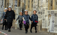 The Famous Five on the White Kippah Mission  OR: Band on a run (ybiberman) Tags: portrait boys children israel candid jerusalem streetphotography tzitzit kippah eatingbag meahshearim pashkvil