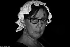 Repressed anger. (Neil. Moralee) Tags: neilmoralee neil moralee nikon d7100 18300mm woman girl female anger glasses spectacles face close wild eyes black white blackandwhite mono monochrome blackbackground onblack beauty pretty angry rage upset sad disappointed mad bad whicked wicked shock people candid lady cap dress mother daughter sister granny elderly mature maturity hemyock devon uk british bw