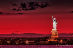 Shining Lady Liberty @ Dusk (Gobinath Mallaiyan) Tags: blue bluehour bluemagic brightcolour city colour colourimage lightmagic longexposure magic multicoloured nyc nycbluehour nycmagichour naturalpattern nightscape nopeople photostream photography sunset
