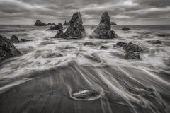Copper coast (Shots in the dark) Tags: countywaterford ireland ie coppercoast coast monochrome blackandwhite beach blackwhite rocks waves waterford waterscapes waterscape sea seascape seascapes cloudsscape