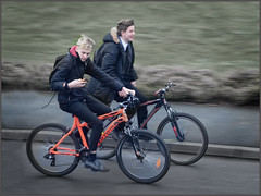 Hands Free Texting (rogermccallum) Tags: bike bikers cyclist cycling mobilephone texting nohands street schoolboy schoolboys