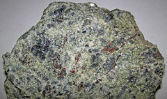 Garnetiferous metanorthosite (Marcy Anorthosite, Mesoproterozoic, 1155 Ma; Rt. 73 roadcut near Chapel Pond, Adirondack Mountains, New York State, USA) 2 (James St. John) Tags: anorthosite metanorthosite plagioclase feldspar igneous rock rocks marcy precambrian proterozoic mesoproterozoic adirondacks adirondack mountains new york state garnet