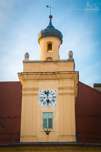 A clock on top of museum of Slavonija