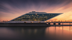 Dockland 7 (digital_underground) Tags: dockland germany sonyalpha zeiss building architecture harbour harbor river hamburg elbe water sunset gold
