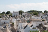 IMG_7098 (jaglazier) Tags: 2016 73116 alberobello apulia architecture buildings chimneys cityscapes copyright2016jamesaglazier deciduoustrees domes hills houses italy july roads roofs stackedstone trees trulli urbanism vaults cities clouds panorama stonebuildings streets unescoworldheritagesites whitewash puglia