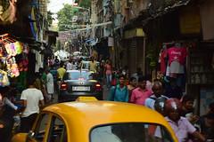 Side street in Calcutta (victoriaei) Tags: india calcutta kolkata october outdoors streetscenes ambassador street taxi people shops stalls travel d5300 indianstreetphotography streetphotography asia nikon