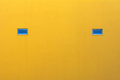Two blue windows in a yellow wall (Jan van der Wolf) Tags: map160125v wall muur blue yellow two minimalism minimalistic minimalisme minimal minimlistic
