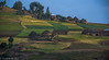 Fertile fields in Ethiopian village (Peraion) Tags: villagem ethiopia africa houses huts fields sky