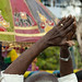 Bald Man Raising His Arms Above His Head During Masi Magam Festival In Pondicherry India