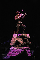 "Michael McGurk as The Fiddler in the Music Circus production of ""Fiddler on the Roof"" at the Wells Fargo Pavilion Aug 14-19. Photo by Charr Crail."