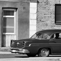 Urban transport (mimmith) Tags: street windows shadow summer urban blackandwhite window car architecture blackwhite shadows transport citylife oldcar capture bnw coolcar vrmland whiteandblack hotsummerday meandmycamera streephoto swedishbuilding smalltowninsweden
