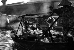 Smokey Boat (Odkaella) Tags: light blackandwhite woman reflection travelling water monochrome lines backlight river boat haze asia market smoke culture steam wanderlust vietnam ripples mekongdelta floatingmarket cantho