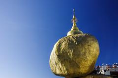 Kyaiktiyo Pagoda (pietkagab) Tags: trip travel blue sky tourism rock religious photography gold golden pagoda site asia paint pentax outdoor burma religion picture buddhism scene adventure document myanmar southeast legend birma pilgrimage prayers warship k5 goldenrock kyaiktiyopagoda buggha pentaxk5ii pietkagab piotrgaborek