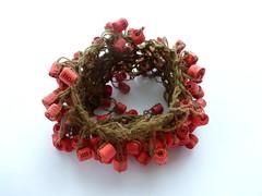 may my gestures mend (Ines Seidel) Tags: bracelet wristband beads paper yarn text red rot armband jewelry jewellery perlen papierperlen schmuck papierschmuck